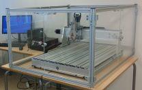 Suojaseinällinen CNC-yläjyrsin pöytämalli